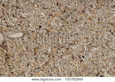 osb - oriented strand board or qsb - quаlity strаnd bоard chipboard texture or chipboard background with copy space for text or image.