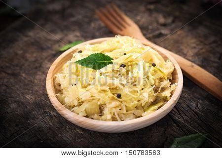 Steamed Sauerkraut On Old Wooden Background