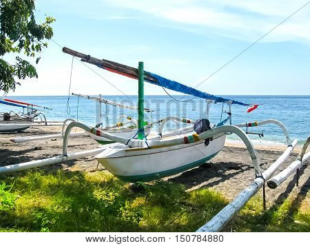 The traditional Balinese boat on a Amed beach in Bali Indonesia