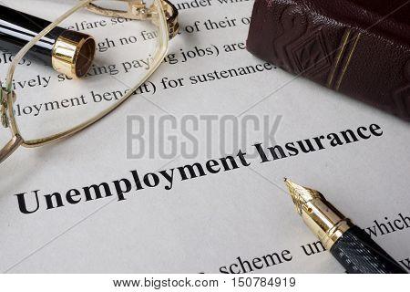 Unemployment insurance concept written on a paper.