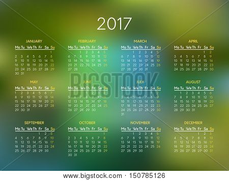 Vector calendar for 2017 year with abstract green blurred background. Week starts on monday