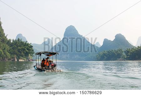 Yangshou, China - September 23, 2016: Tourists On A Li River Cruise, With A View At Karst Scenery