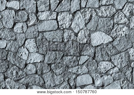 texture of a stone wall of silvery color with an abstract mosaic pattern for backgrounds or for wallpaper