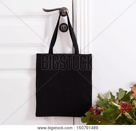 Black cotton eco tote bag design mockup. Handmade shopping bags.
