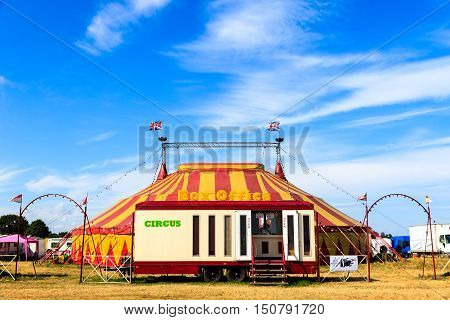 Circus tent and box office against blue sky