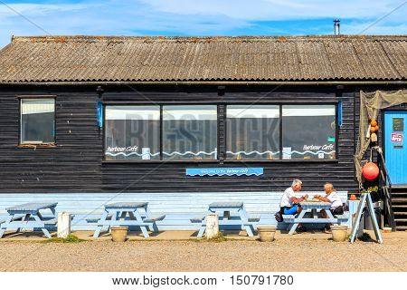 Southwold UK - August 18 2016 - Local cafe next to the River Blyth at Southwold harbour with outdoor picnic benches