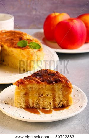 Apple cake with caramel sauce served on plate
