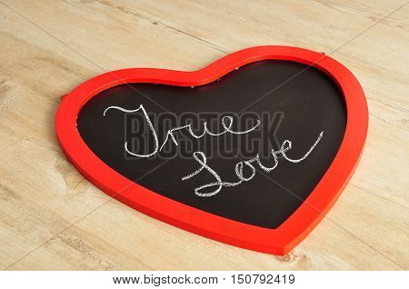 Valentine's Day. A heart shape black board with true love written on it