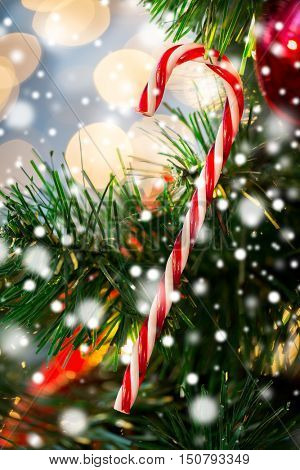 holidays, x-mas, decor and celebration concept - close up of close up of sugar cane candy decoration on christmas tree