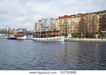 SAVONLINNA, FINLAND - MAY 10, 2014: Vew of the sity embankment of the cloudy may in the afternoon. Tourist landmark of the Savonlinna, Finland