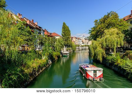Ljubljana, Slovenia - September 22, 2016: the scenic Ljubljanica river with weeping willows on the embankment.