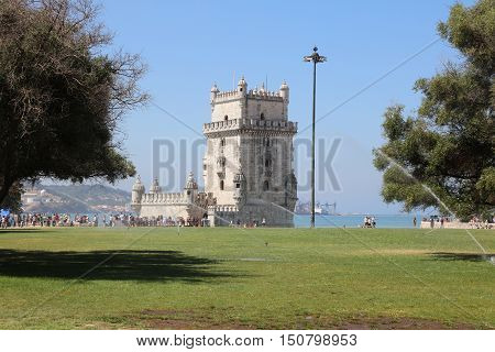 Lisbon, Portugal - July 28, 2016: Tourists at Belem Tower (Tower of Saint Vincent), one of the major tourist attractions in Lisbon. Portugal