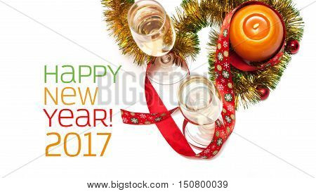 New year 2017 greeting card made of two glasses of champagne yellow and green tinsel with red christmas balls red ribbon with snowflakes and orange candle with chinese hieroglyph for rooster horizontal top view