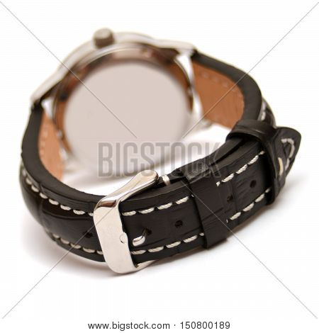 Watch with a black leather strap isolated on white background