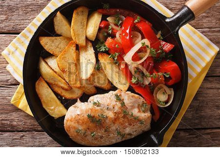 Spicy Chicken With Fried Potatoes And Warm Salad Of Peppers Closeup. Horizontal Top View