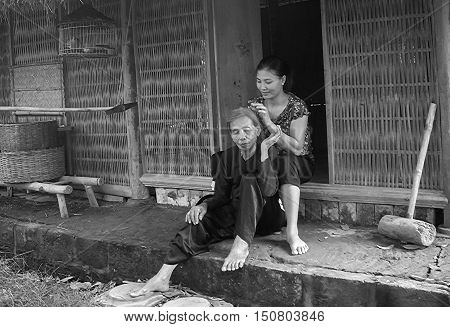 HA NOI, VIET NAM, September 24, 2016 the mother and daughter, sit and enjoy a simple cottage, suburb of Ha Noi