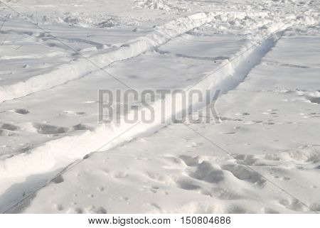 Tire tracks in the fresh snow. Road Winter.