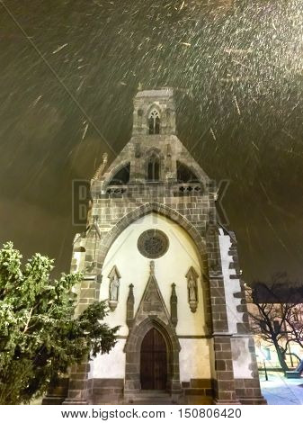 St. Michael chapel in the main square of Kosice city in eastern Slovakia at snow night