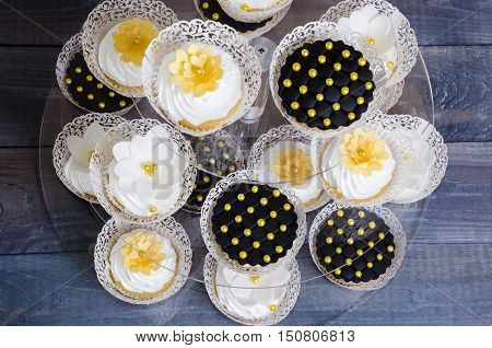 Wedding Gold And Black Cupcakes In Lace Wrappers
