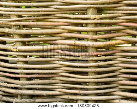 Texture of ukrainian traditional wicker fence. Natural background