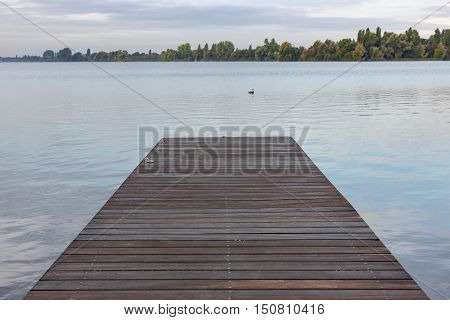 Wooden pier at Dutch lake in the early morning