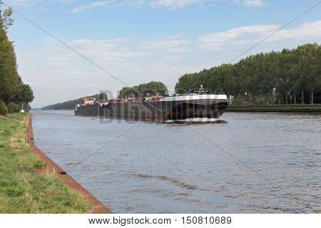 Big barge navigating at Dutch canal near Amsterdam