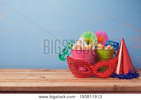 Jewish holiday purim background with carnival mask hat and buckets