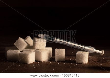 Disease - diabetes. Sugar with syringe for injection