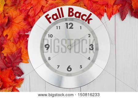 Fall Time Change Some fall leaves and a clock on weathered wood with text Fall Back
