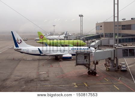 Moscow, Russia - November 07, 2015: Planes at the quay ramp Domodedovo airport in foggy weather.
