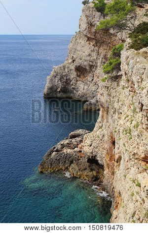 This is the Croatian island of Dugi Otok leaving its rocky steep west coast in the open Adriatic Sea.