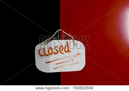 An abstract red door closed with a hand written message left, closeup shot