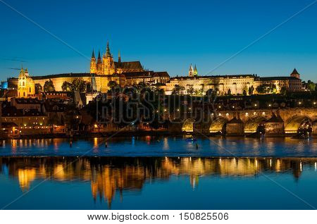 View on Vltava river and St.Vitus cathedral in Prague Castle at night Czech Republic