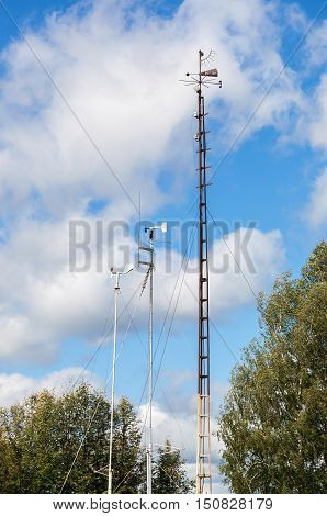 Devices of meteorological station wind meter on the blue sky background