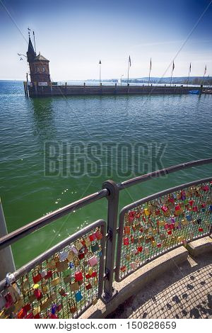 Padlocks in harbor of Konstanz city with a view to lake Constance. Konstanz is a city located in the south-west corner of Germany on borders with Switzerland.