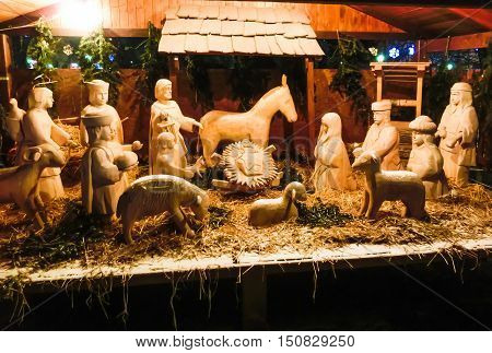 The Holy Family. Christmas wooden decorations outside.