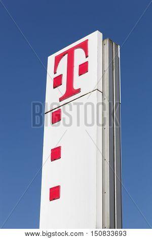 Flensburg, Germany - June 4, 2016: Deutsche Telekom sign on a panel. Deutsche Telekom is a German telecommunications company headquartered in Bonn