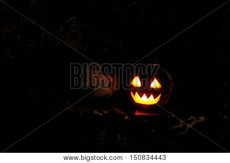 fabulous face glowing on Halloween in the darkness