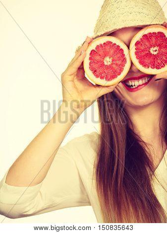 Woman Holds Two Halfs Of Grapefruit Citrus Fruit In Hands