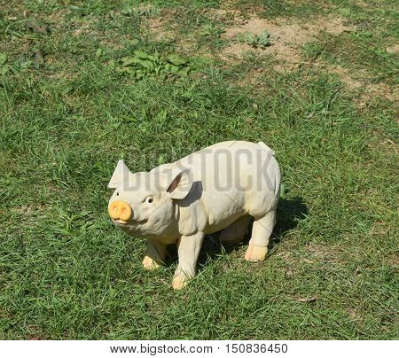 Plastic Toy Pig. Figures Pigs On The Lawn
