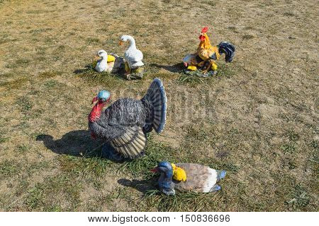 Toy Turkeys And Chickens In The Meadow. Home Decorations Of The House
