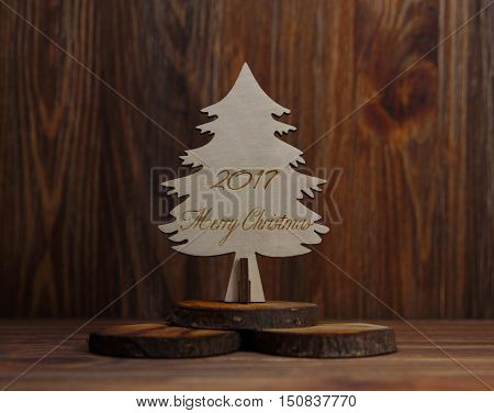 Christmas tree on a stub on a wooden background