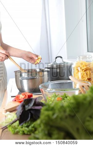 Cook's Hands Preparing Vegetable Salad - Closeup Shot