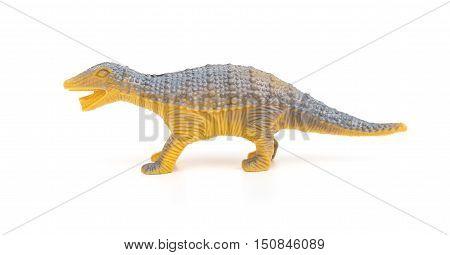 side view orange plastic dinosaur toy on a white background