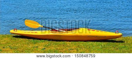 Yellow Kayak On River Bank