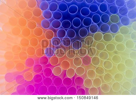 horizontal image of an over head view of the tops of different colored drinking straws great for background image.