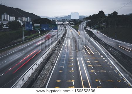 People busy commuting with cars using highway between cities.