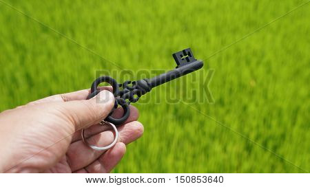 Hand holding a key to a new property
