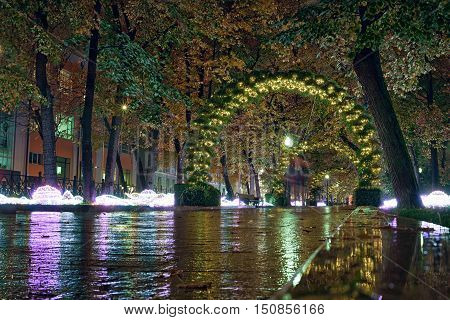 Passion Boulevard Moscow Russia. Street decorations in the form of an light arches of sunflowers at night.