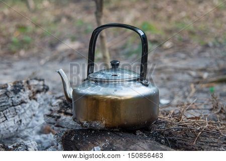 Close up water boiling in camping area